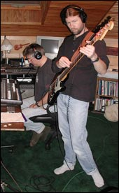 John Doerschuk at the mixing board and Kirk Foster on bass laying down a track.
